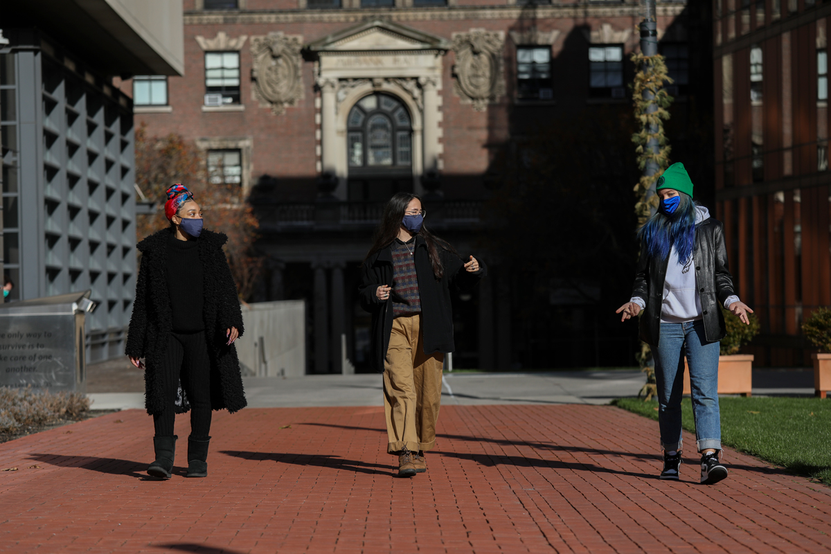 3 student Barnard health ambassadors walk on campus while socially distanced